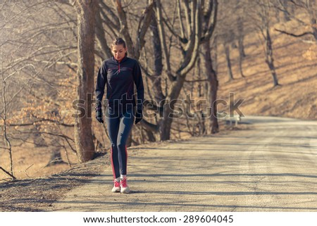 Woman relaxing after a long run in nature. - stock photo