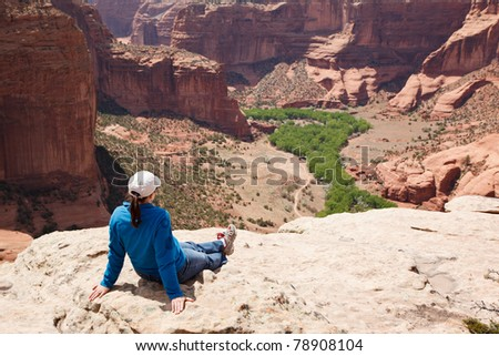 Woman Relaxing and Admiring View of a Canyon - stock photo