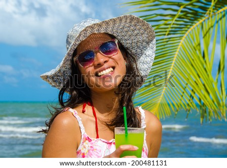 Woman relaxing and drinking Cocktail