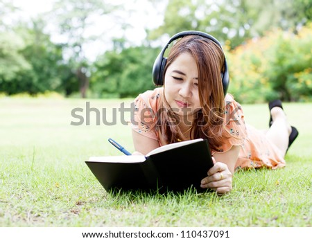 Woman relaxing and reading book