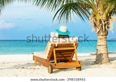 Woman relaxing and reading on deckchair