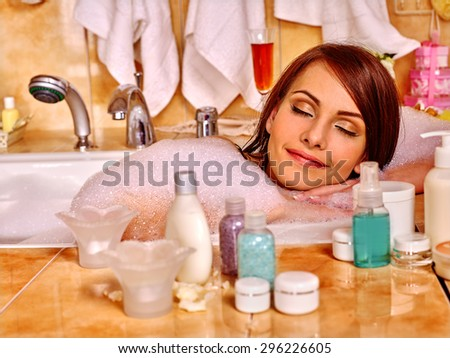 Woman relaxing and sleep at water in bubble bath. - stock photo