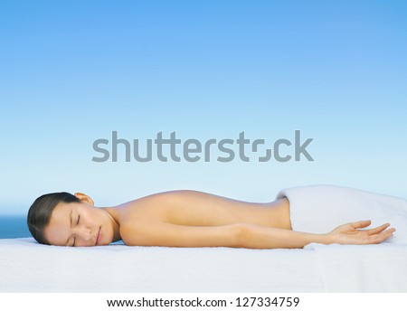 Woman relaxing and sunbathing in spa - stock photo