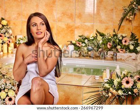 Woman relaxing at flower water spa. Looking up. - stock photo