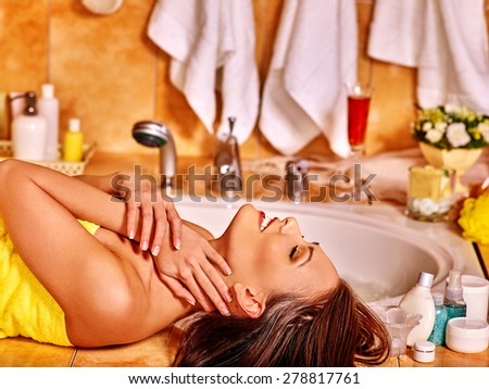 Woman relaxing at home luxury bath. Looking up. - stock photo