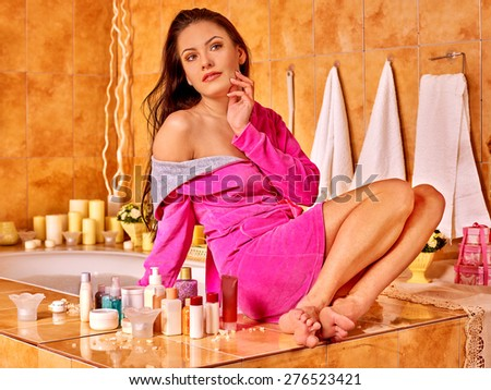 Woman relaxing at home luxury bath. Pink bathrobe. - stock photo