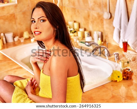 Woman relaxing at home luxury bath. Yellow towel. - stock photo