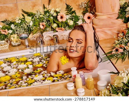 Woman relaxing at luxury water flower spa. - stock photo