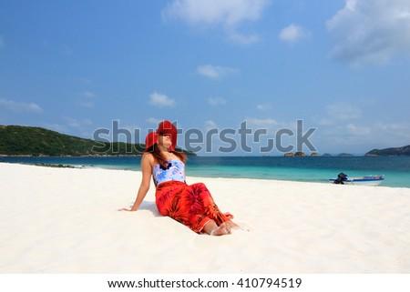 Woman relaxing at the beach enjoying her freedom ,Vacation Start Here Concept, - stock photo