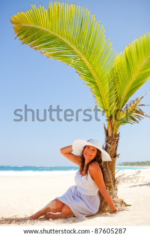 Woman relaxing at the beach looking very happy - stock photo