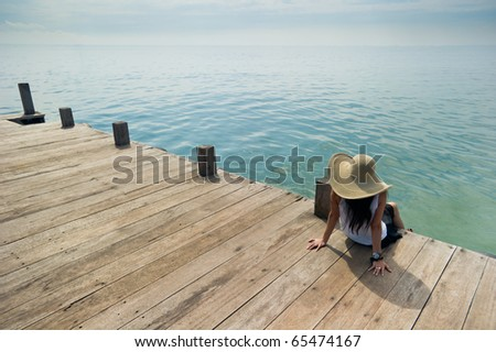 woman relaxing at the dock - stock photo