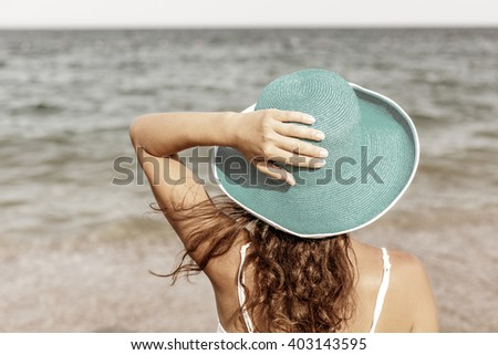 Woman relaxing at the seaside. Vintage style. - stock photo