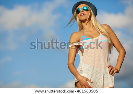 woman relaxing at the sky background . Summer hipster vacations concept