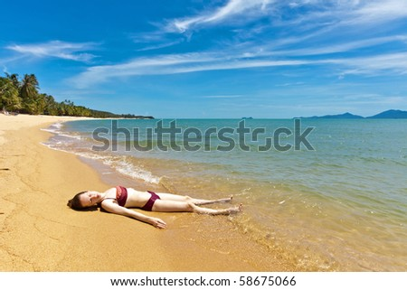 Woman relaxing at the tropical beach