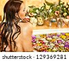 Woman relaxing at water spa. - stock photo