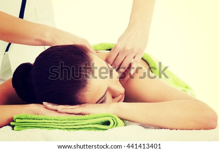 Woman relaxing beeing massaged in spa saloon - stock photo