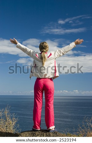 Woman relaxing by the sea - stock photo