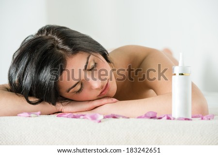 Woman relaxing during spa procedures - stock photo