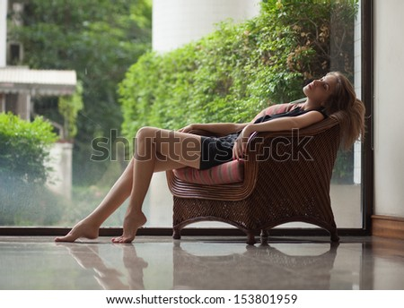 Woman relaxing in a chair - stock photo