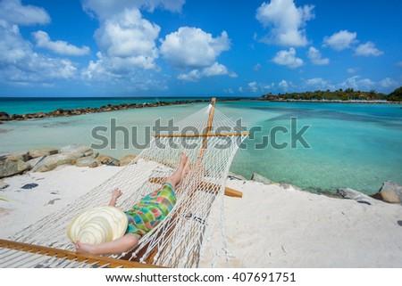 Woman relaxing in a hammock - stock photo