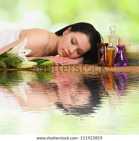 woman relaxing in a spa - stock photo