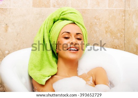 Woman relaxing in bath with eyes closed - stock photo