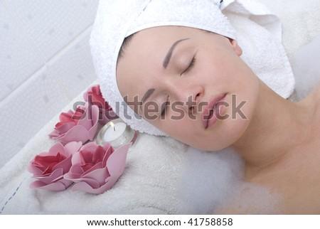Woman relaxing in bathroom - stock photo