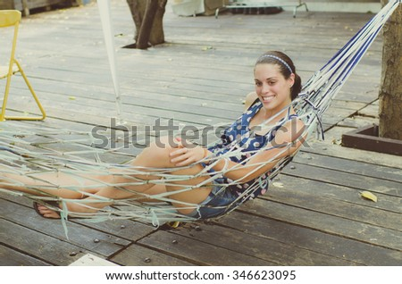 Woman Relaxing In Beach Hammock