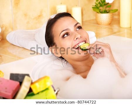 Woman relaxing in bubble bath . - stock photo