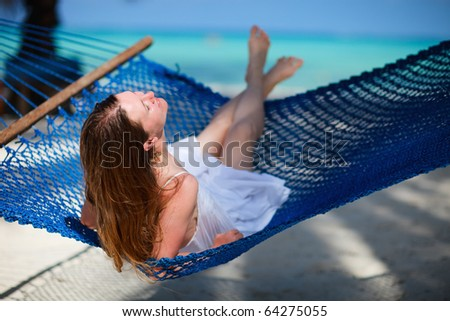 Woman relaxing in hammock - stock photo