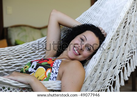 woman relaxing in hammock at home - stock photo