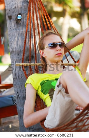 Woman relaxing in hammock on the tropical beach - stock photo