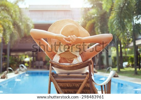woman relaxing in luxury hotel, summer holidays - stock photo