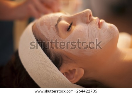 Woman relaxing in spa, facial mask