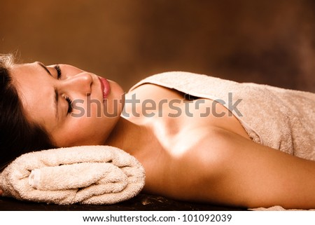 woman relaxing in spa salon - stock photo