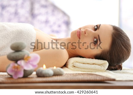 Woman relaxing in spa salon