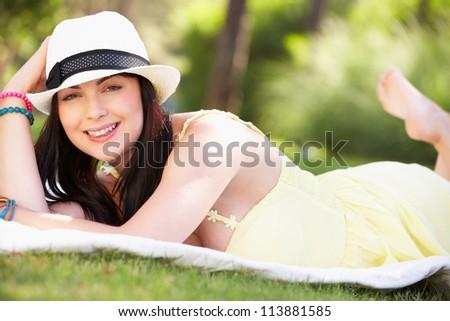 Woman Relaxing In Summer Garden - stock photo