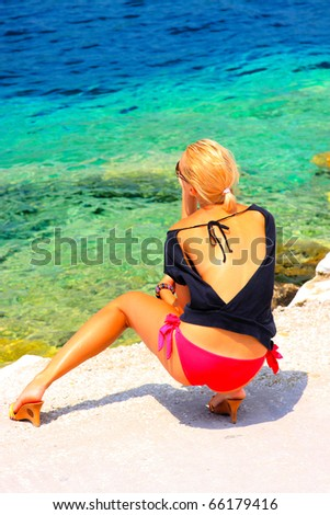 woman relaxing in the afternoon by the sea - stock photo