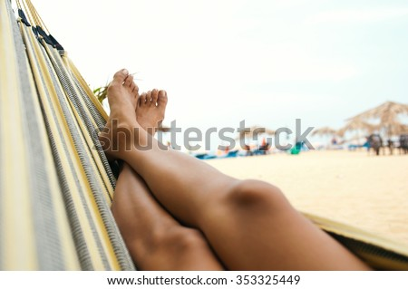 Woman relaxing in the hammock at the beach - stock photo