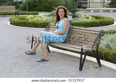 Woman relaxing in the park - stock photo