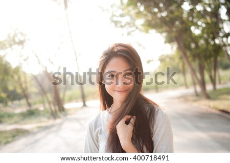 Woman relaxing in the park on a clear day
