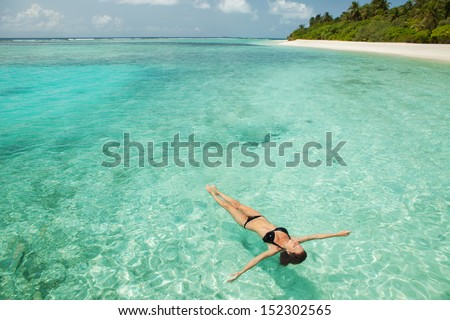 Woman relaxing  in the sea