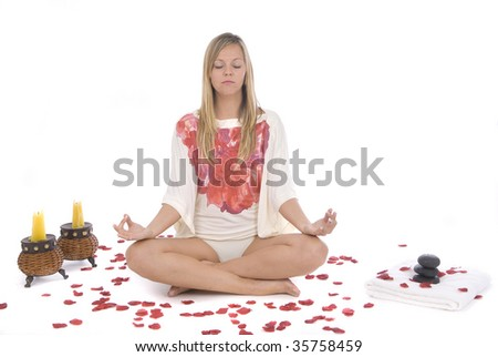 woman relaxing in yoga meditation with white background - stock photo