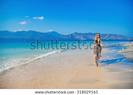 woman relaxing on a tropical island Gili Air - stock photo