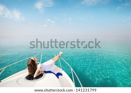 woman relaxing on a yacht in the sea. relaxation on the water - stock photo