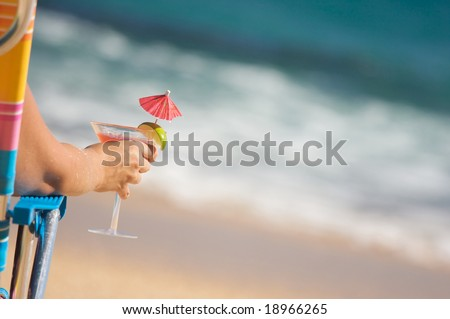 Woman Relaxing on Beach with Tropical Drink. - stock photo