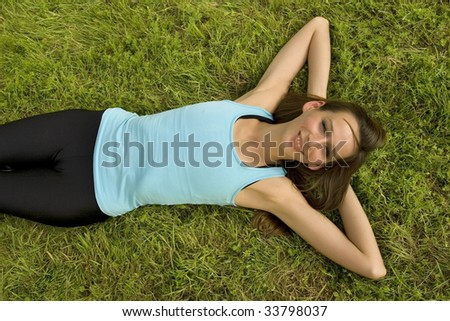 woman relaxing on grass and enjoying the sun