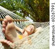 woman relaxing on hammock with eyes closed. Front view, Square  shape - stock photo