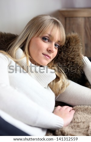 Woman relaxing on sofa - stock photo