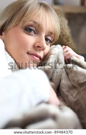 Woman relaxing on sofa - stock photo